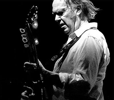 Neil Young old palying guitar